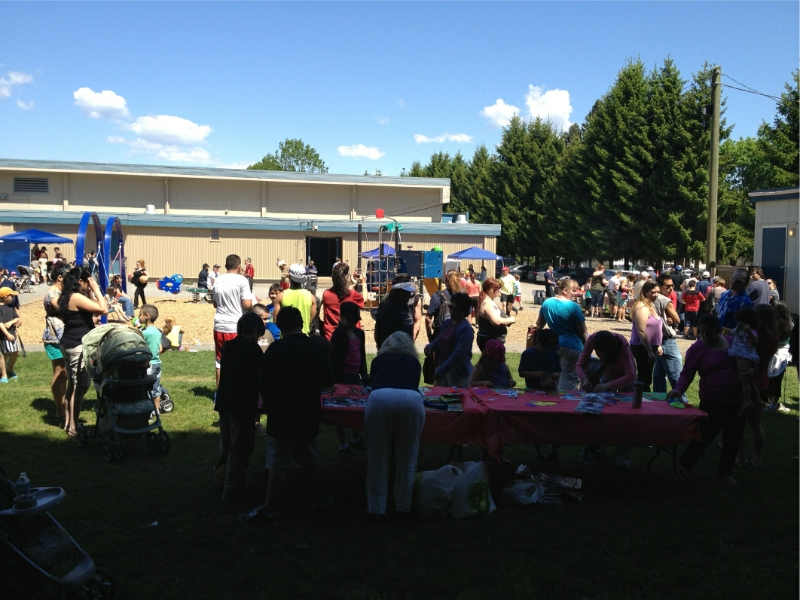 The activity table in the forefront, face painters, a balloon clown and labour music added to the festivities